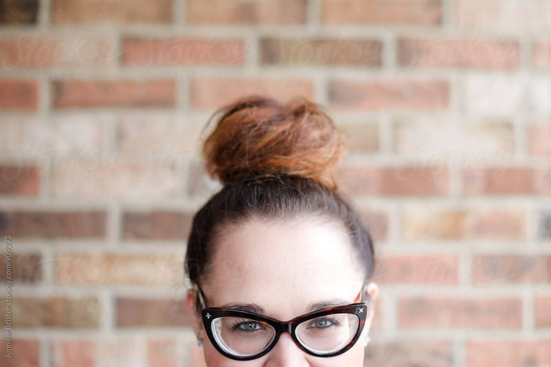 Beautiful woman with cat eye glasses by Jen Brister for Stocksy United