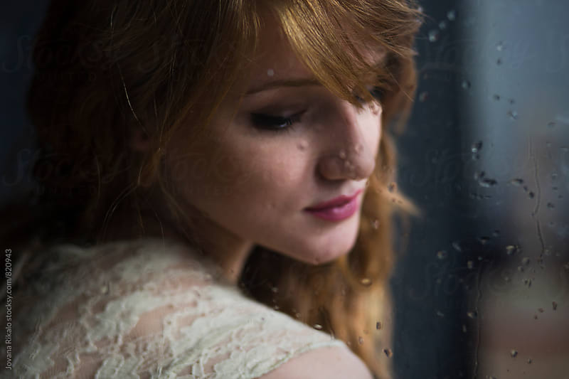Portrait of a beautiful young woman and rainy window by Jovana Rikalo for Stocksy United