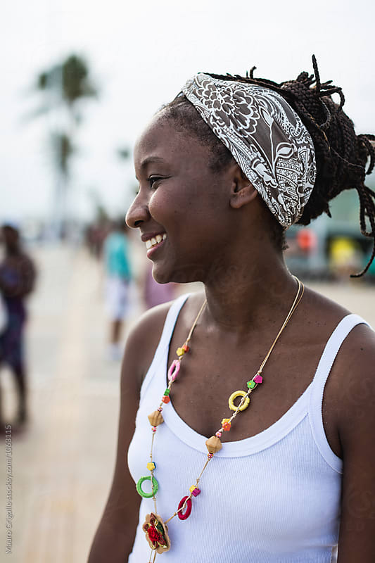 Portrait of a Brazilian woman walking in the city. Salvador de Bahia. by Mauro Grigollo for Stocksy United