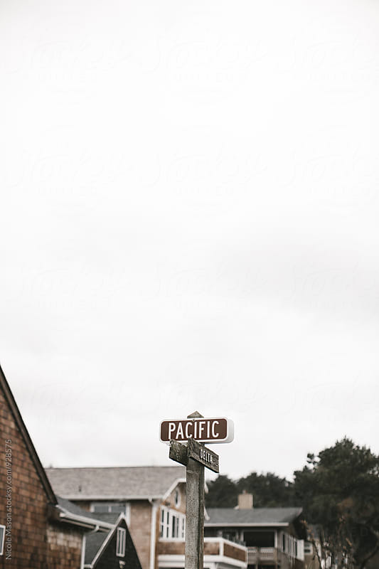 pacific street sign at oregon coast by Nicole Mason for Stocksy United