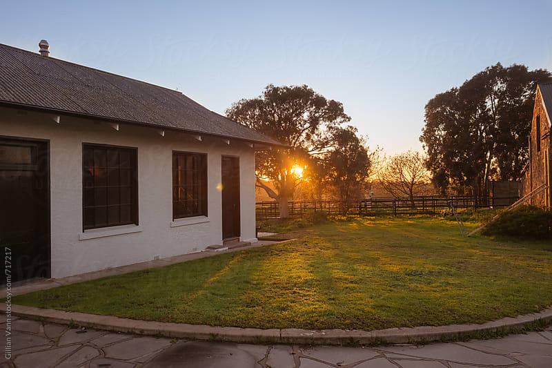 sunrise on the farmhouse by Gillian Vann for Stocksy United