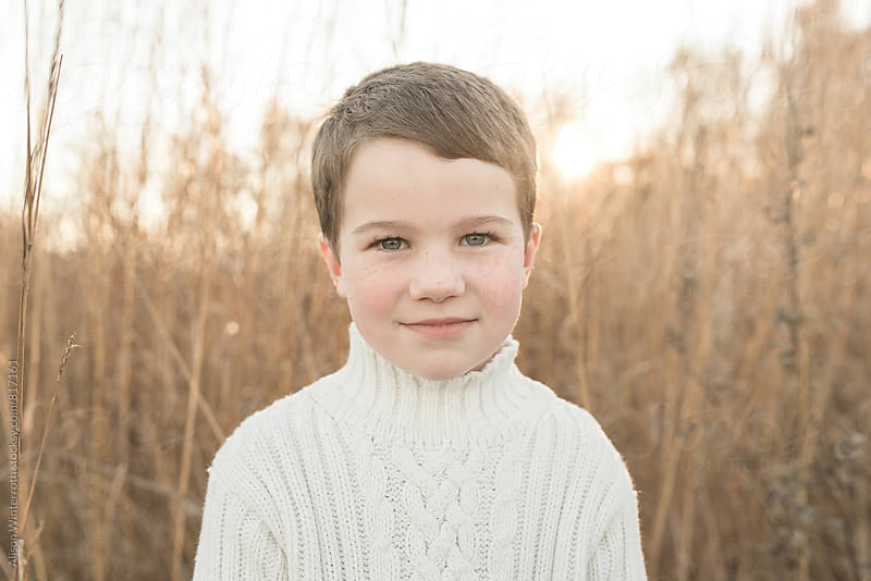 Boy Looking At Camera Seriously by Alison Winterroth for Stocksy United