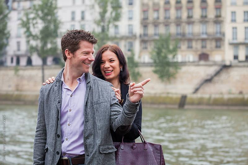 Couple on the banks of the Seine River by Shelly Perry for Stocksy United