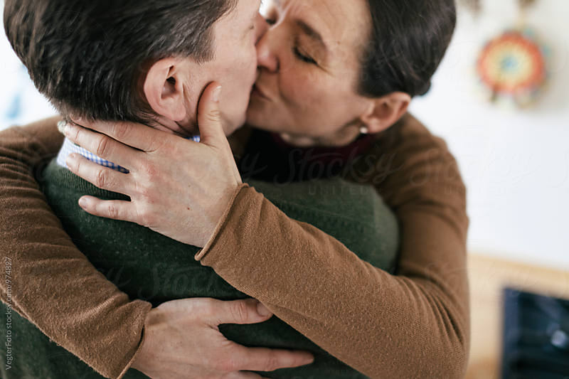 Mature Couple Kissing by VegterFoto for Stocksy United