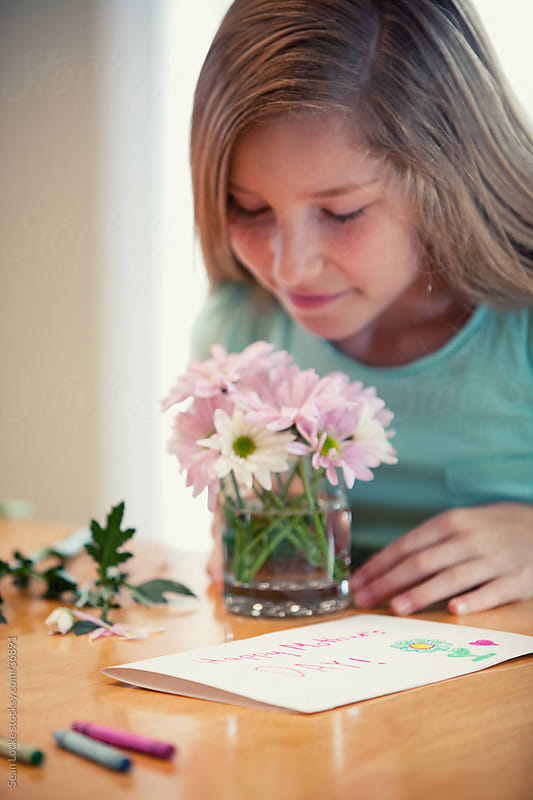 Mother's Day: Girl Makes Flower Arrangement for Mom by Sean Locke for Stocksy United