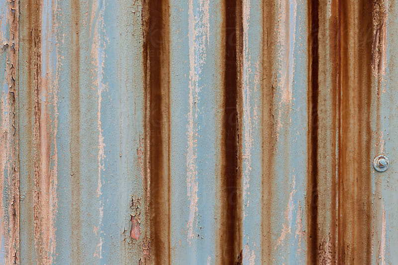 Flaking and rusty corrugated Metal Sheets attached to a building by Paul Phillips for Stocksy United