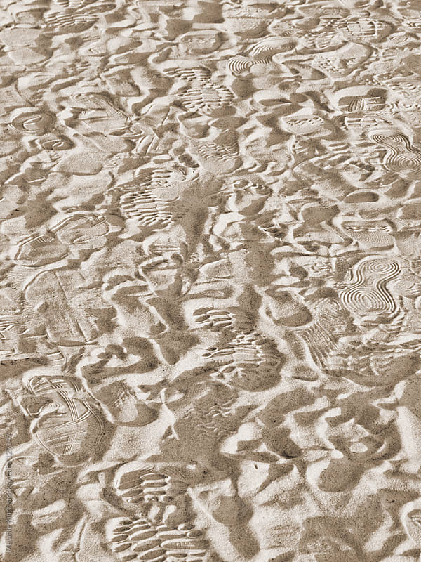 Background made from footprints in sand by Melanie Kintz for Stocksy United