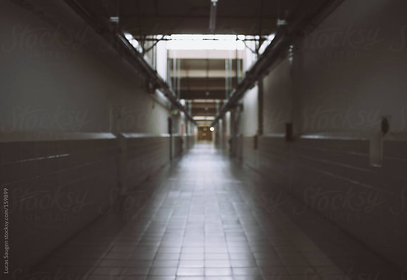 A really long hallway in a commercial space and out of focus. by Lucas Saugen for Stocksy United