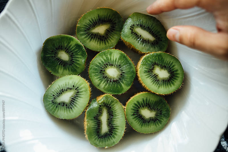 Bowl of kiwifruit  by ZOA PHOTO for Stocksy United