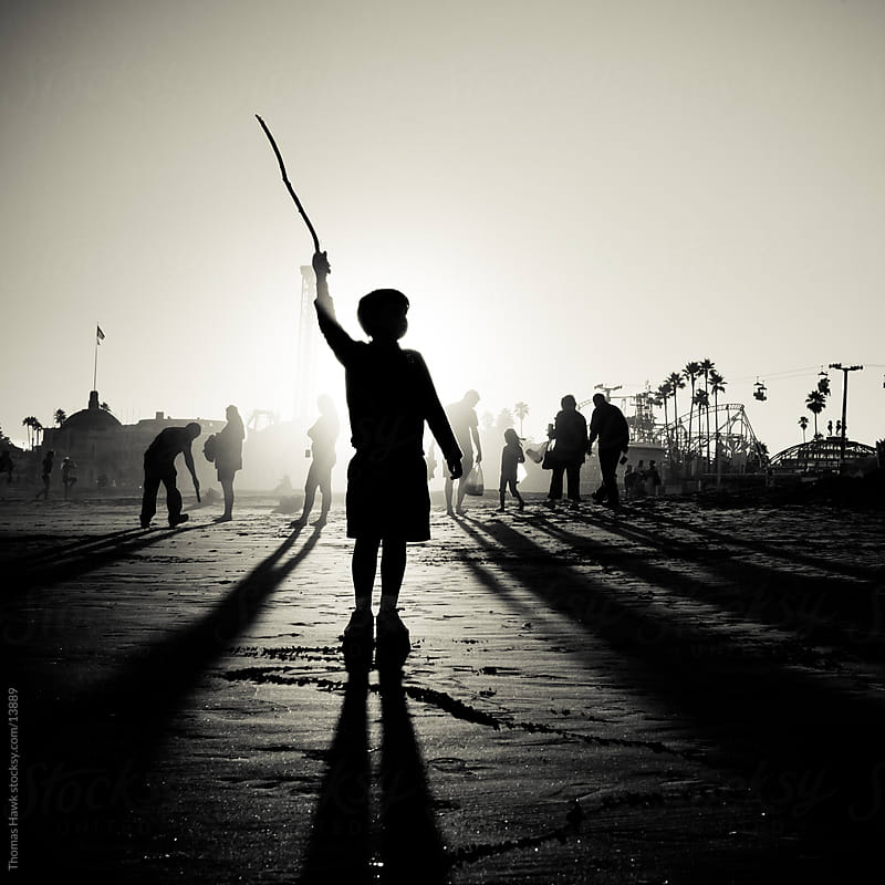 Boy with stick at beach by Thomas Hawk for Stocksy United