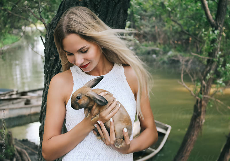 Woman wit rabbit by Milles Studio for Stocksy United