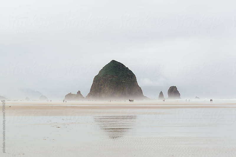 Haystack Rock and misty sea in Cannon Beach by michela ravasio for Stocksy United