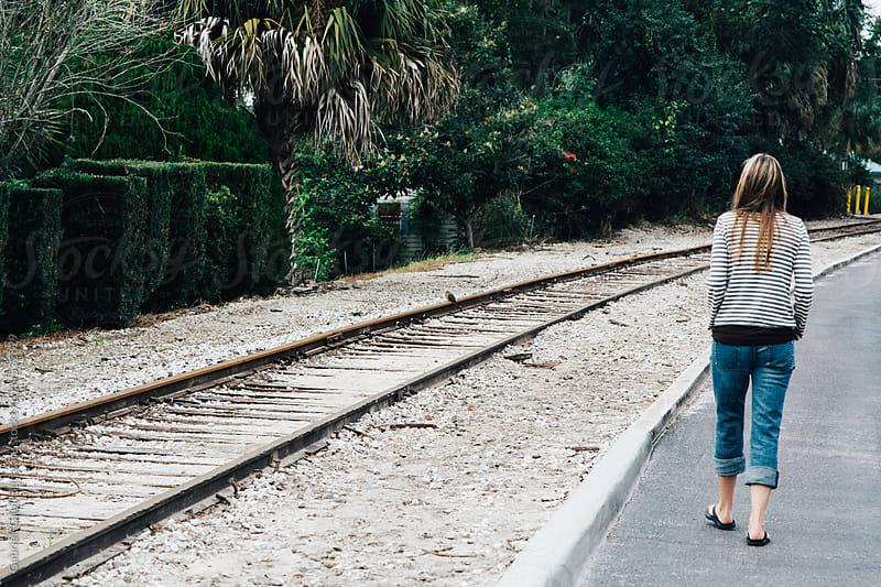 Woman waiting for train in a train station by Gabriel (Gabi) Bucataru for Stocksy United
