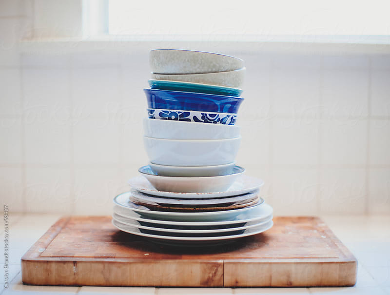 stack of dishes on cutting board by Carolyn Brandt for Stocksy United