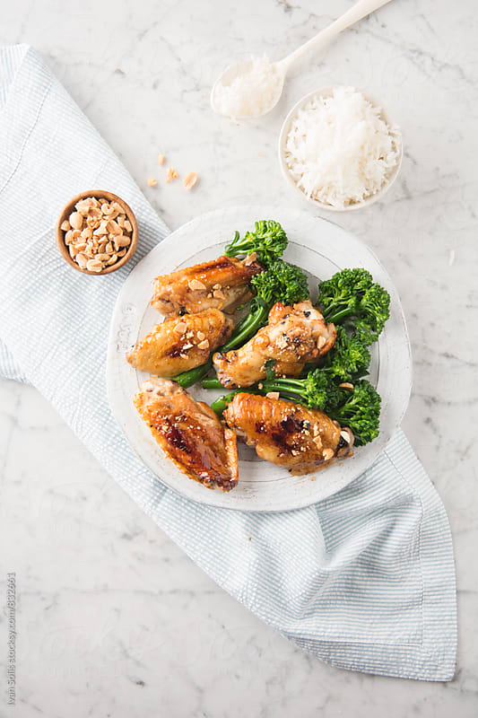 Asian style chicken wings by Ivan Solis for Stocksy United