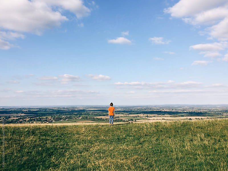 Boy looking out over view in Oxfordshire by Kirstin Mckee for Stocksy United