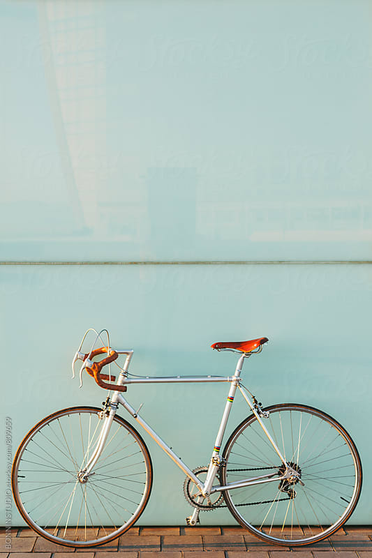 Vintage bicycle on blue background. by BONNINSTUDIO for Stocksy United