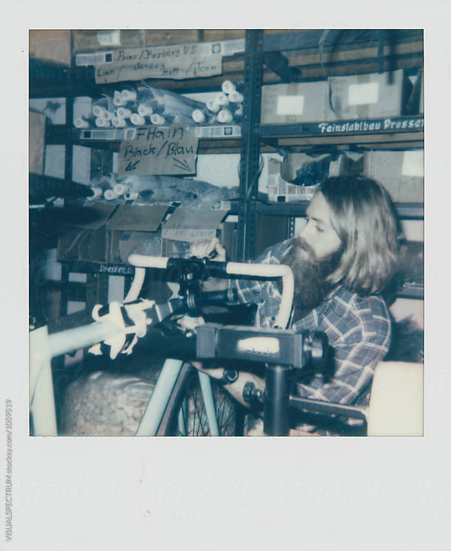 Polaroid Photograph of Male Hipster Assembling Fixed Gear Bicycle by Julien L. Balmer for Stocksy United