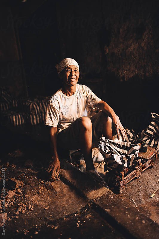 Balinese Woman with Headscarf making Seafood Bricks. by Gary Radler Photography for Stocksy United