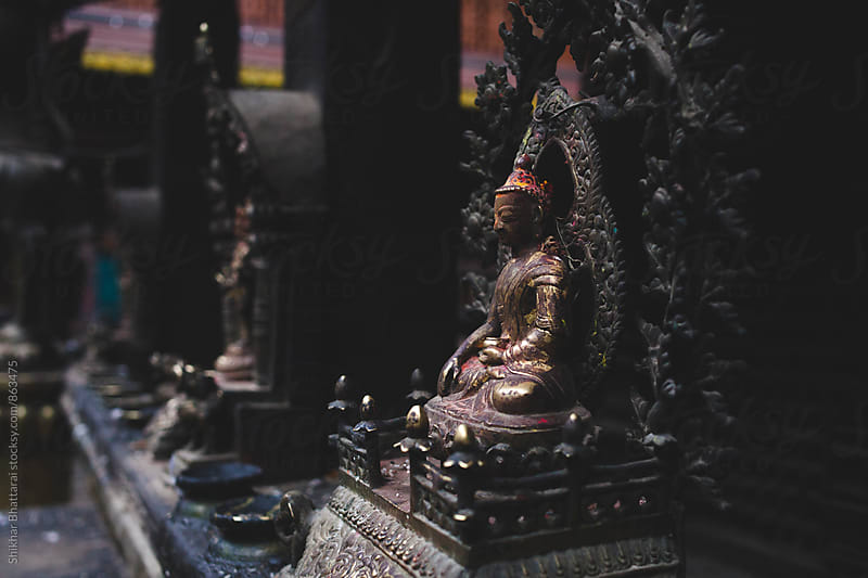 Close up of statue of Buddha in Golden Temple, Patan, Nepal. by Shikhar Bhattarai for Stocksy United