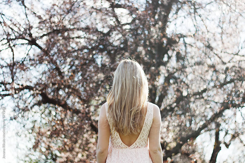 Girl looking at a tree,from behind by Jovana Rikalo for Stocksy United
