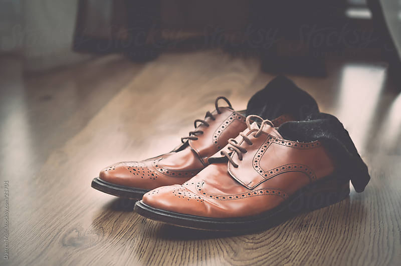 Scruffy tan brogues. by Darren Muir for Stocksy United