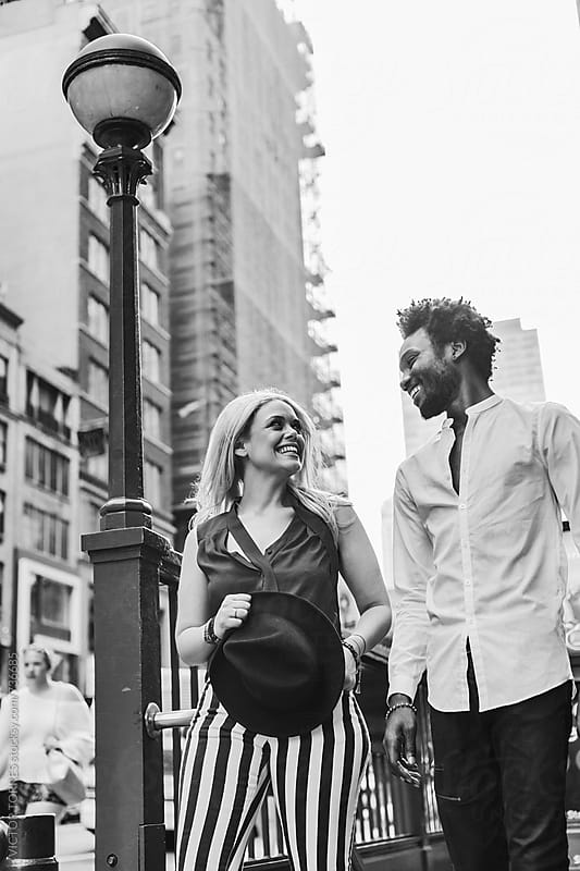 Multi-ethnic Couple in the Streets of Manhattan, New York by Victor Torres for Stocksy United
