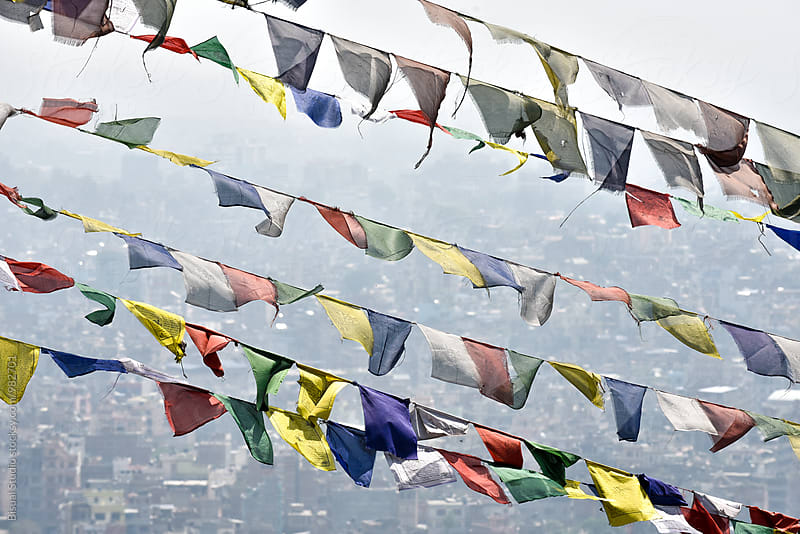 Prayer Flags in fog  above Kathmandu by Bisual Studio for Stocksy United