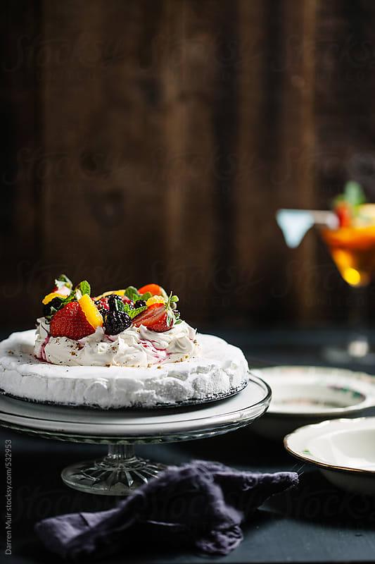 Summer fruit pavlova on table. by Darren Muir for Stocksy United