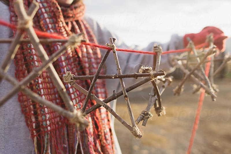 series of handmade diy stars hanging on thread by Tana Teel for Stocksy United