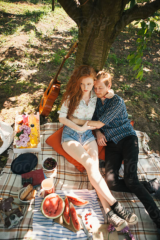 Couple in Love on a Picnic by Lumina for Stocksy United