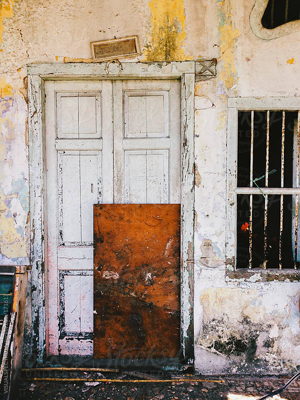 Closed Door in Old Building by VISUALSPECTRUM for Stocksy United