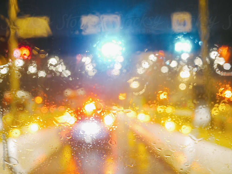 rainy windshield lights traffic by rolfo for Stocksy United