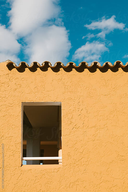 Window on a Stucco Wall by VICTOR TORRES for Stocksy United
