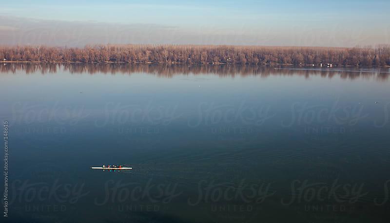 Team rowing on river by Marko Milovanović for Stocksy United
