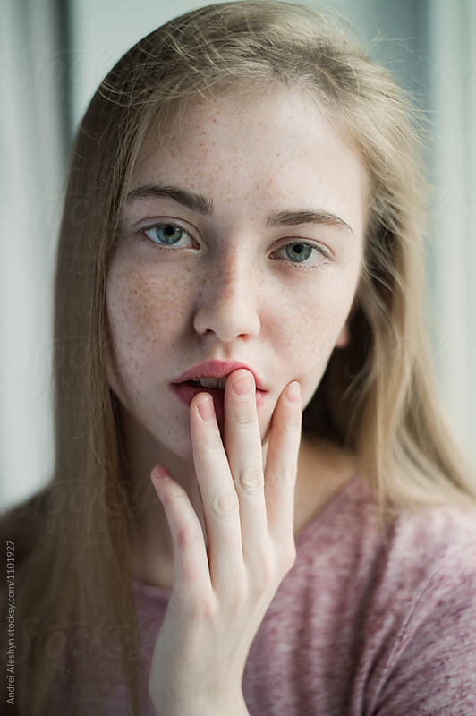 portrait of a beautiful girl with freckles by Andrei Aleshyn for Stocksy United