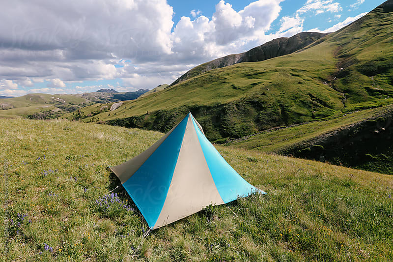 Single camping tent in outdoor meadow by Matthew Spaulding for Stocksy United