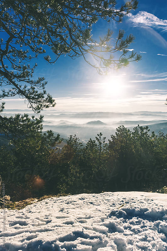 Beautiful view on mountains in the fog by Dimitrije Tanaskovic for Stocksy United