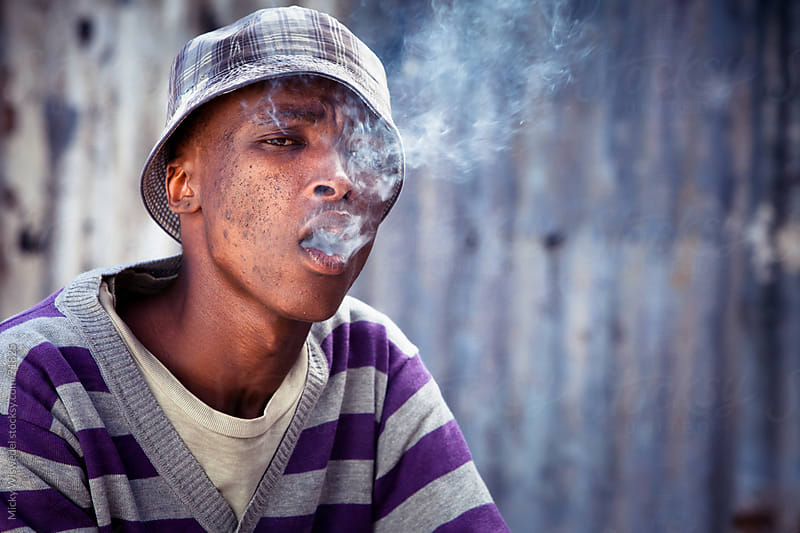 Township Man Smoking by Micky Wiswedel for Stocksy United