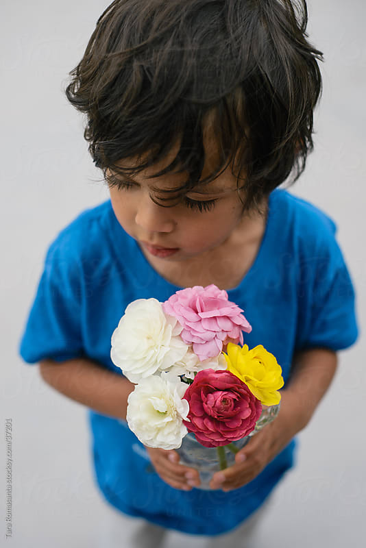 boy with bouquet: flowers for mom by Tara Romasanta for Stocksy United