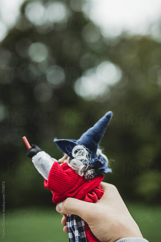 Hand holding witch toy by Tatjana Ristanic for Stocksy United