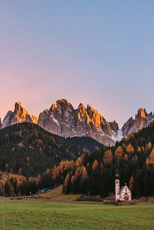 St Johann Church in the  Val di funes with the Geisler Mountain group in the back by Leander Nardin for Stocksy United
