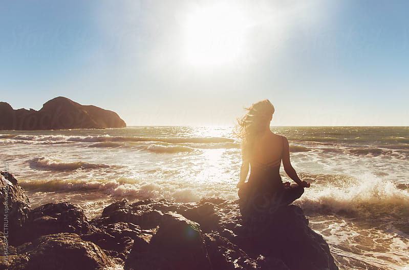 Pretty Woman Meditating by the Ocean by VISUALSPECTRUM for Stocksy United