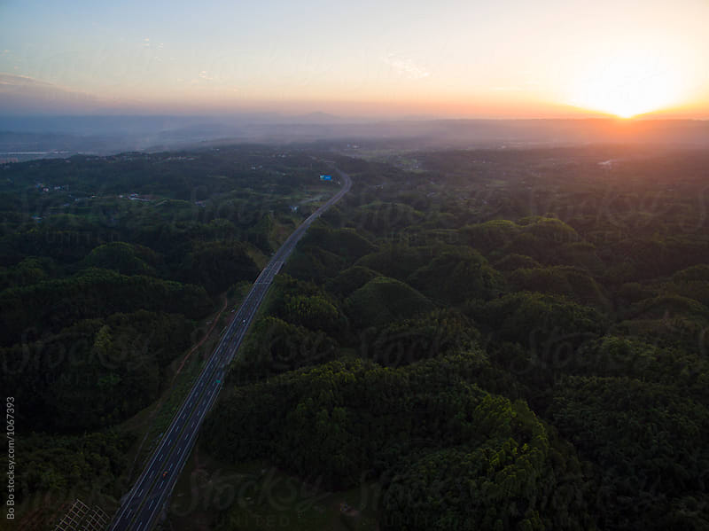 aerial view of highway at sunset by cuiyan Liu for Stocksy United