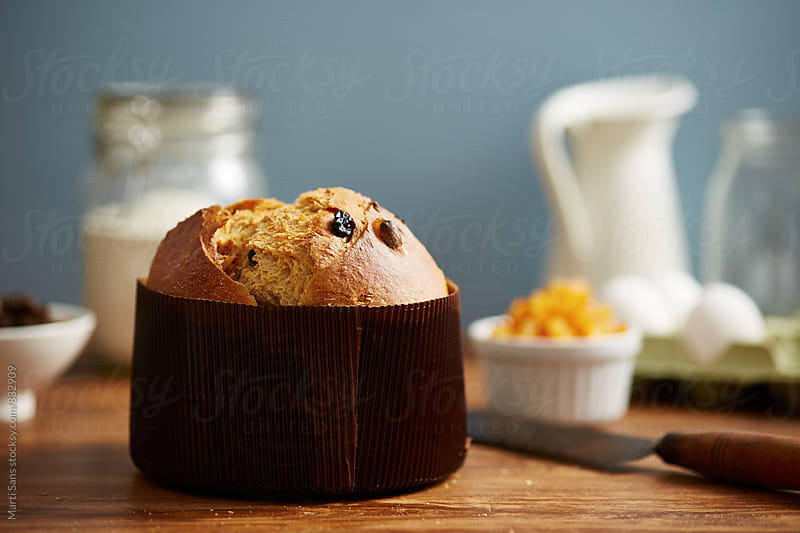 Baked panettone in cake pan on table by Martí Sans for Stocksy United