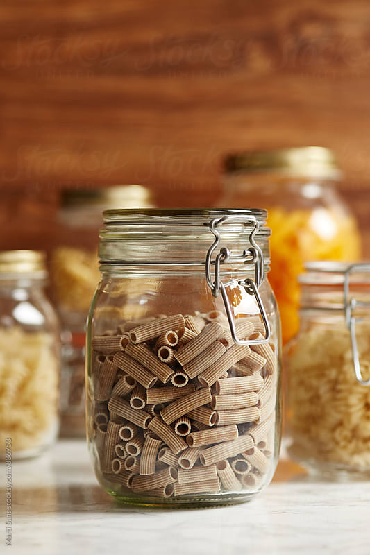 Close-up of oat flour pasta in glass  jar by Martí Sans for Stocksy United