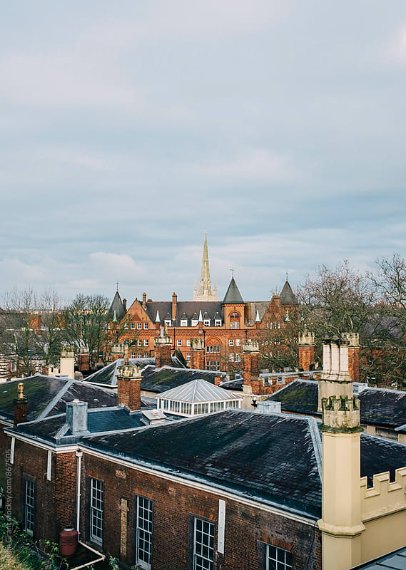 City rooftop view with church spire beyond. Norwich, Norfolk, UK. by Liam Grant for Stocksy United