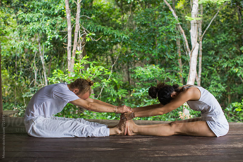 Two People Practicing Partner Yoga by Mosuno for Stocksy United
