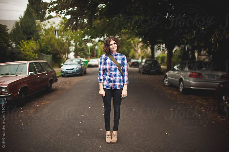 Girl Standing in Neighborhood Street by Kevin Gilgan for Stocksy United