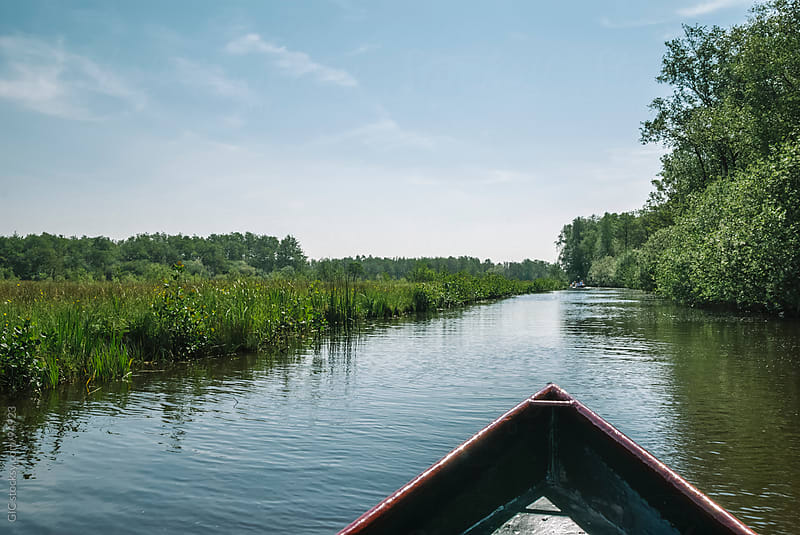 Boat during an exploretion through canals in Netherlands by GIC for Stocksy United